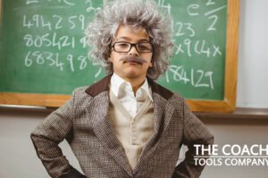 Little Einstein in front of blackboard with Coaching Questions to Get Unstuck
