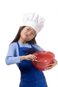 career coaching tools - girl pondering while baking cookies