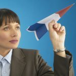goal-setting templates and worksheets image - woman imagining with paper aeroplane