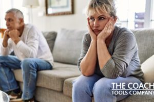 Couple arguing on sofa feeling disconnected