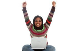 Woman-excited-Laptop
