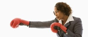 woman-with-boxing-gloves-medium-599x250