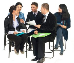 five-business-people-sitting-on-chairs-crop-for-web