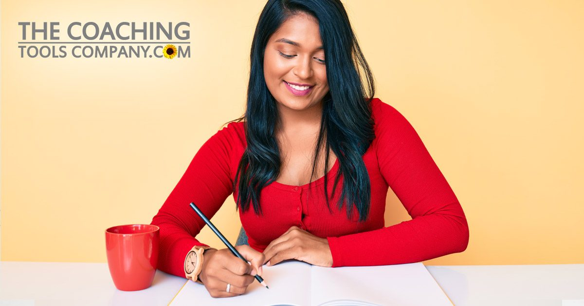 Woman Journaling for Success on Desk