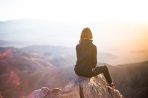 Woman at top of mountain looking at view