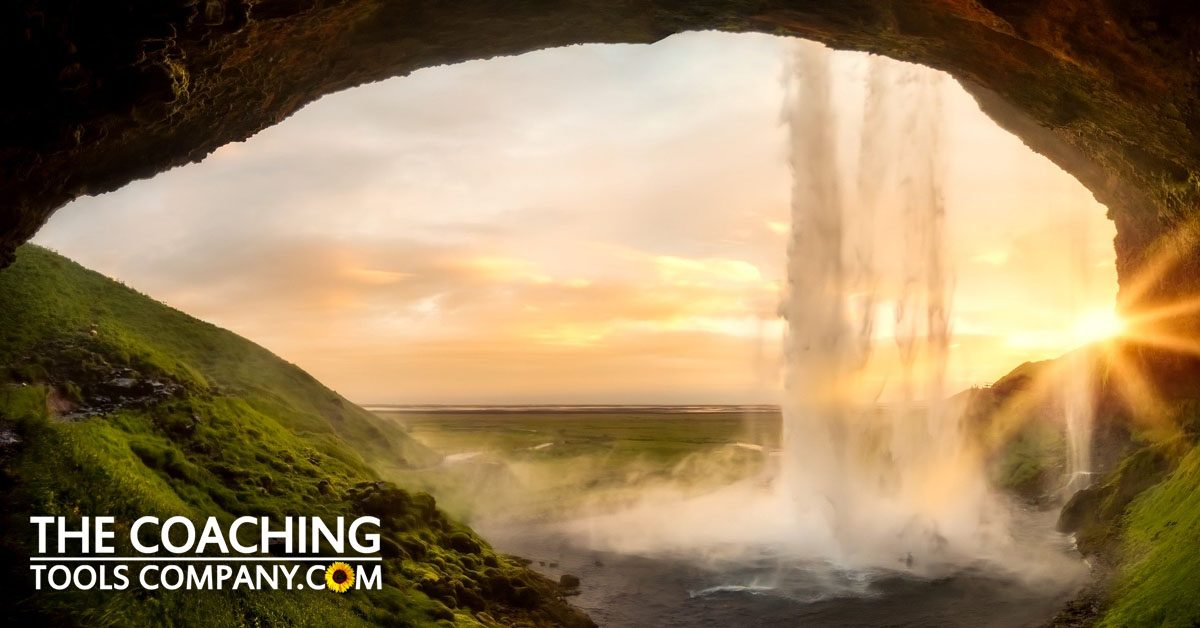Looking out of cave in iceland - showing awe & wonder in coaching